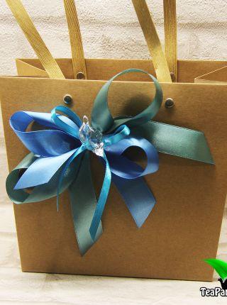 Cумочка подарочная из крафт бумаги декорированная бантом